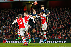 George Friend of Middlesbrough heads the ball as Danny Welbeck of Arsenal challenges - Photo mandatory by-line: Rogan Thomson/JMP - 07966 386802 - 15/02/2015 - SPORT - FOOTBALL - London, England - Emirates Stadium - Arsenal v Middlesbrough - FA Cup Fifth Round Proper.