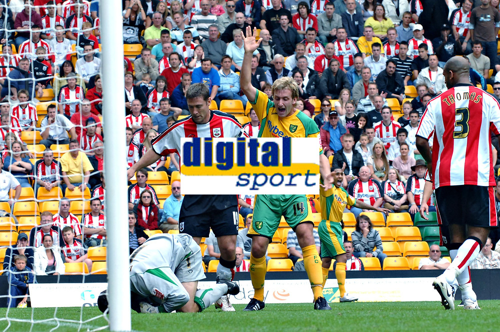Photo: Ashley Pickering.<br /> Norwich City v Southampton. Coca Cola Championship. 18/08/2007.<br /> Chris Makin's (L stripes) back pass to Southampton goal keeper Kelvin Davies sets up Norwich's first goal