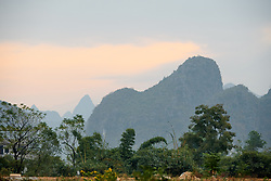 Sunrise over the karst mountains at GREE Tour of Guangxi Women's WorldTour 2019 a 145.8 km road race in Guilin, China on October 22, 2019. Photo by Sean Robinson/velofocus.com