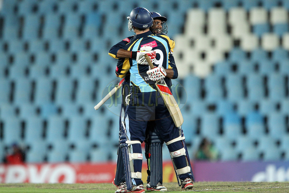 Gary Ballance celebrates the win with Adil Rashid during the 4th Qualifying match of the Karbonn Smart CLT20 South Africa between Trinidad & Tobago and Uva Next held at Supersport Park Stadium in Centurion, South Africa on the 10th October 2012..Photo by Ron Gaunt/SPORTZPICS/CLT20