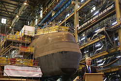 Defence Secretary Michael Fallon speaks in front of HMS Audacious at BAE Systems, Burrow-in-Furness, where he will attend a steel-cutting ceremony to formally commence production of the UK's next generation of nuclear submarines.