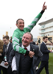 Jockey Davy Russell celebrates winning the Pertemps Network Final Handicap Hurdle with Trainer Patrick Kelly during St Patrick's Thursday of the 2017 Cheltenham Festival at Cheltenham Racecourse.