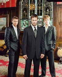 three men in suits indoors