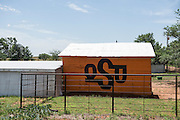 A small barn painted OSU colors with OSU logo just northwest of Fort Supply.