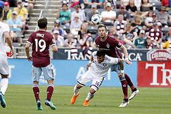 April 29, 2018 - Commerce City, Colorado - Colorado Rapids defender Danny Wilson (4) heads the ball over Orlando City SC forward Dom Dwyer (14) in the second half of action in the MLS soccer game between Orlando City SC and the Colorado Rapids at Dick's Sporting Goods Park in Commerce City, Colorado (Credit Image: © Carl Auer via ZUMA Wire)