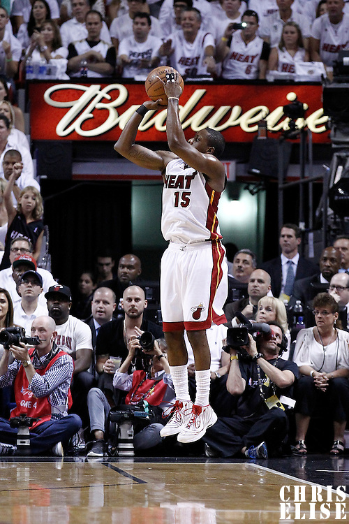 19 June 2012: Miami Heat point guard Mario Chalmers (15) takes a three points jumpshot during the first quarter of Game 4 of the 2012 NBA Finals, Thunder at Heat, at the AmericanAirlinesArena, Miami, Florida, USA.