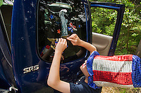 Zander Mini puts a Lady Liberty decal on the truck window before the annual Gilmanton 4th of July parade on Saturday morning.  (Karen Bobotas/for the Laconia Daily Sun)