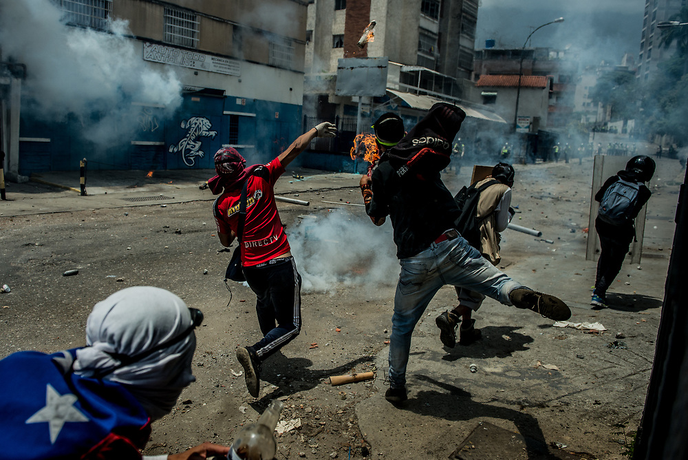 CARACAS, VENEZUELA - APRIL 19, 2017:  Thousands of protesters took to the streets today in Venezuela to show their discontent with the government.  They were met by riot police that fired tear gas and rubber bullets at them.  Some protesters responded by throwing rocks and petrol bombs.  Venezuela is in crisis, and residents face daily struggles over food and medicine shortages, and one of the highest crime rates in the world.  PHOTO: Meridith Kohut
