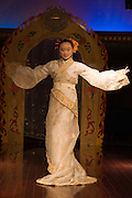 Dancer performing traditional show on Victoria Line Cruise Ship for Western tourists, Yangtze River, China
