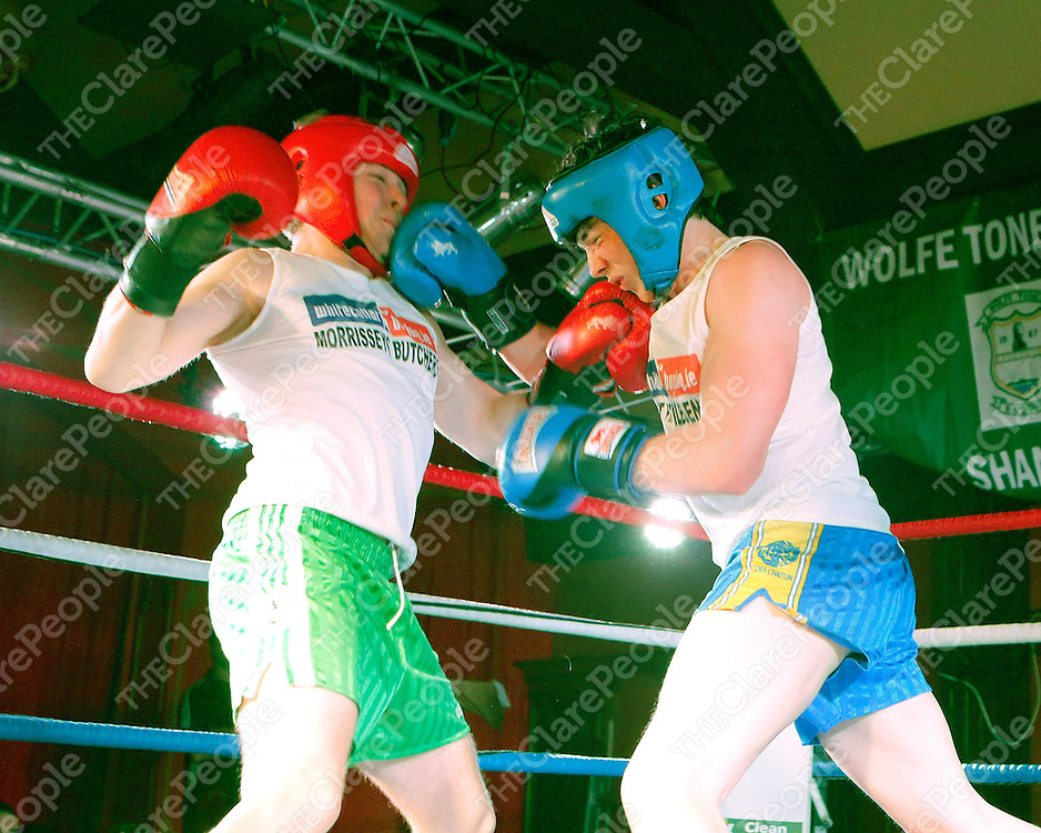 16/03/2014<br /> Kevin &quot;Butcher Boy&quot; McCafferty of Wolfe Tones GAA, Shannon in action against Paudie &quot;Concussion&quot; Conway of Newmarket on Fergus GAA at the White Collar Boxing tournament at the Oakwood Arms Hotel, Shannon. <br /> Picture: Don Moloney / Press 22