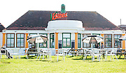 Exclusive <br /> Heather Mills cafe V-Bites relaunch today and it seems no one has turned up for the Grand Opening, Heather left her sister Fiona,<br />  to open up who then took time out sitting outside the cafe smoking with friends not the launch Heather would have wanted!<br /> <br /> ©Darren Cools/Exclusivepix