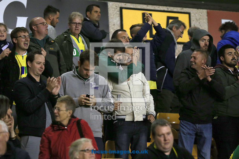 The traveling Norwich fans celebrate victory at the end of the Sky Bet Championship match at Molineux, Wolverhampton<br /> Picture by Paul Chesterton/Focus Images Ltd +44 7904 640267<br /> 01/10/2016