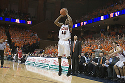 Sean Singletary shoots a three pointer against Arizona.  UVA defeated the #10 ranked Wildcats 93-90 in the first game at the new John Paul Jones Arena, in Charlottesville, VA on November 12, 2006...