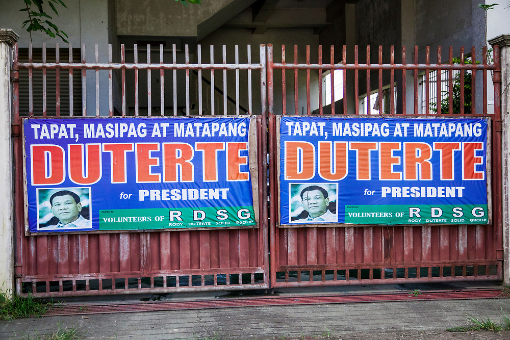 Samal Island, Mindanao, Philippines - JUNE 23: A poster in support of President Duterte is seen posted in front of a residential gate.