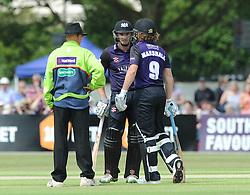 Hamish Marshall of Gloucestershire speaks with Michael Klinger of Gloucestershire after picking up an injury - Photo mandatory by-line: Dougie Allward/JMP - Mobile: 07966 386802 - 12/07/2015 - SPORT - Cricket - Cheltenham - Cheltenham College - Natwest Blast T20