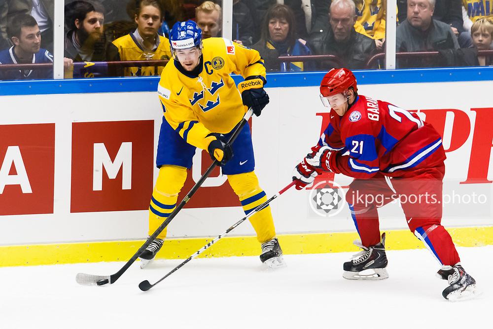 140104 Ishockey, JVM, Semifinal,  Sverige - Ryssland<br /> Icehockey, Junior World Cup, SF, Sweden - Russia.<br /> Filip Forsberg, (SWE), Alexander Barabanov, (RUS).<br /> Endast f&ouml;r redaktionellt bruk.<br /> Editorial use only.<br /> &copy; Daniel Malmberg/Jkpg sports photo