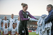 Siobhan Chamberlain (England) (Liverpool) gets her hand stuck in a tracksuit top sleeve as her team mates wait to have the team photo taken before the Women's International Friendly match between England Ladies and Italy Women at Vale Park, Burslem, England on 7 April 2017. Photo by Mark P Doherty.