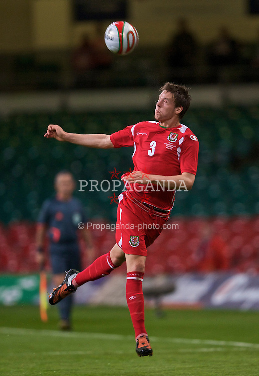 CARDIFF, WALES - Wednesday, September 9, 2009: Wales' Chris Gunter in action against Russia during the FIFA World Cup Qualifying Group 3 match at the Millennium Stadium. (Photo by David Rawcliffe/Propaganda)