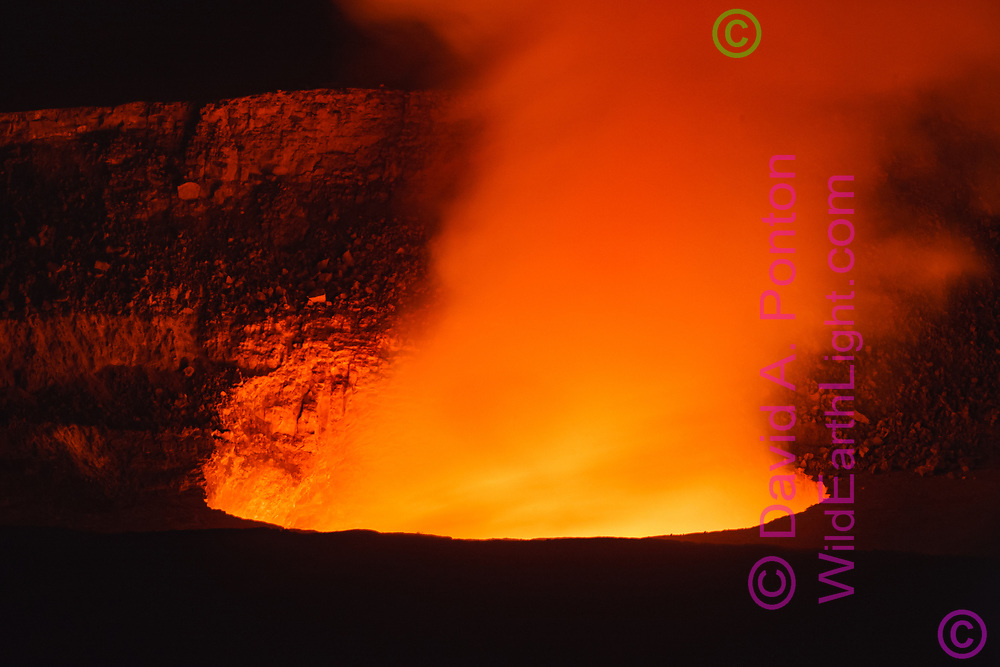 Halema'uma'u vent lit up by lava pool excursion (occassional occurrance) at night inside Kilauea crater, Hawaii Volcanoes National Park, © 2010 David A. Ponton