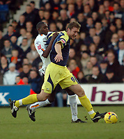 Photo: Kevin Poolman.<br />Luton Town v Derby County. Coca Cola Championship. 18/11/2006. Steve Howard of Derby protects the ball from Leon Barnett of Luton.