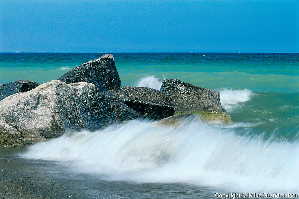 crashing waves on rocks on Lake Ontario<br /> Burlington<br /> Ontario<br /> Canada