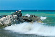 crashing waves on rocks on Lake Ontario<br /> Burlington<br /> Ontario<br /> Canada