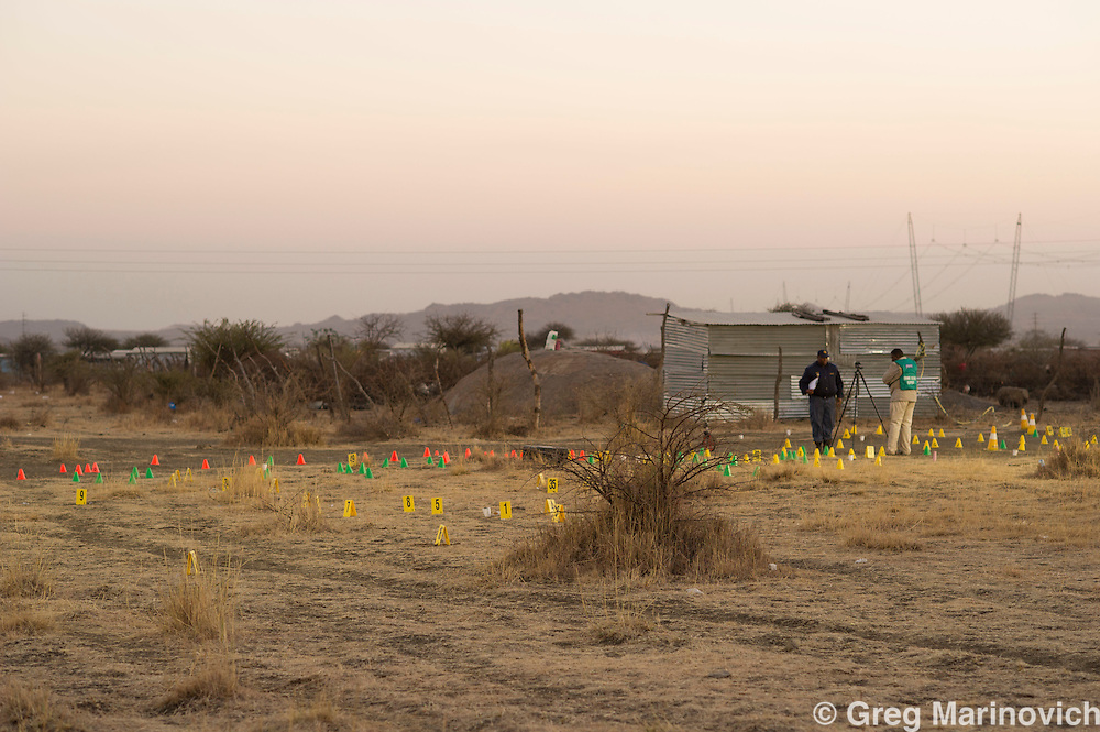 The scene of the massacre at Wonderkop that saw over thirty striking miners killed by police in a bloody conclusion. 17 August, 2012. The firensics ran out of cones for marking evidence, and used coffee cups. Photo Greg Marinovich.