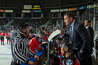 KELOWNA, BC - SEPTEMBER 28: Kelowna Rockets head coach Adam Foote stands on the bench against the Everett Silvertips and speaks to linesman Dustin Minty about a call  at Prospera Place on September 28, 2019 in Kelowna, Canada. (Photo by Marissa Baecker/Shoot the Breeze)