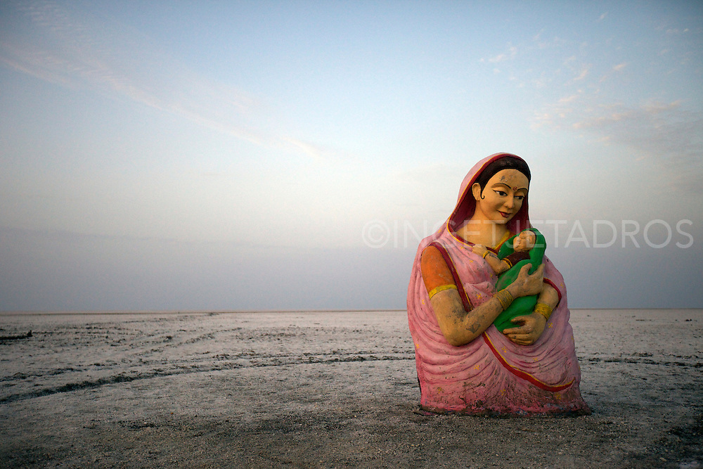 A religious statue dumped in the White Rann Desert  after a Carnival, Kutch,Gujarat,India,2012<br />