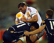Dwayne Sweeney tackled by Francis Fainifo.Super 14 rugby union match, Brumbies v Cheifs, Canberra, Australia. Saturday 19 February 2011. Photo: Paul Seiser/PHOTOSPORT.../SPORTZPICS