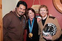 Jon Montgomery shares his gold medal win in the mens' skeleton with Tsimshian artist Philip Gray and local artist Sheree Blanche at the Black Tusk Gallery in Whistler during the 2010 Olympic Winter Games. Montgomery commissioned Gray to paint his animal totem, the Thunderbird, on his helmet. In local first nations culture the Black Tusk is considered the nest of the Thunderbird, and so was Montgomery's choice in locating an artist to create his helmet design.