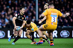 Nic White of Exeter Chiefs is challenged by Wasps - Mandatory by-line: Ryan Hiscott/JMP - 30/11/2019 - RUGBY - Sandy Park - Exeter, England - Exeter Chiefs v Wasps - Gallagher Premiership Rugby