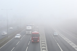 © Licensed to London News Pictures. 06/02/2017. Leeds, UK. A thick blanket of fog covers the M62 motorway on a cold February morning near Leeds in West Yorkshire. Photo credit : Ian Hinchliffe/LNP