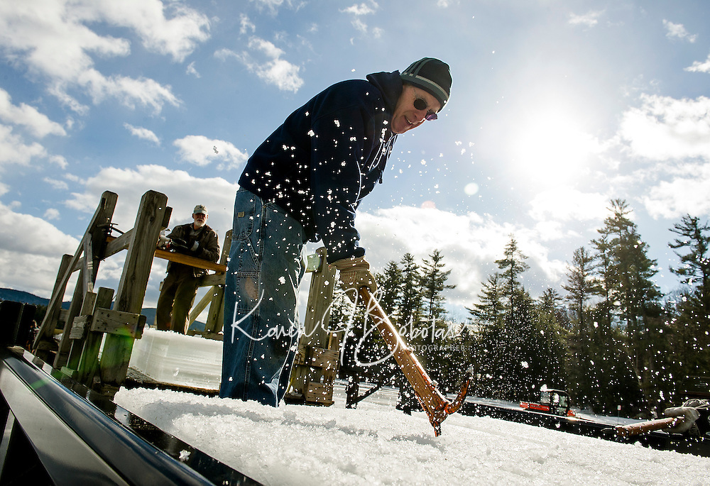 Dave Lacasse slides ice blocks into the back of a truck during the first day of the annual ice harvest with the Rockywold-Deephaven Camp crew on Wednesday.  (Karen Bobotas/for the Laconia Daily Sun)