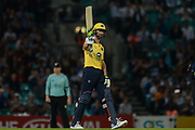 Grant Elliott of Birmingham Bears raises his bat on reaching his half century during the NatWest T20 Blast South Group match between Surrey County Cricket Club and Warwickshire County Cricket Club at the Kia Oval, Kennington, United Kingdom on 25 August 2017. Photo by Dave Vokes.