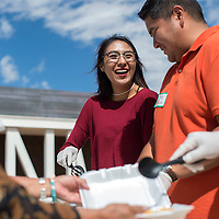 Daisha Holyan, left, and Gregory Begay, with the American Indian Business Association help serve participants of Change Labs at University of New Mexico's Gallup Campus Friday. Change Labs is a collaborative program to promote entrepreneurship. A food truck from Navajo Technical College catered the event outside Gurley Hall.