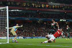 LONDON, ENGLAND - Oct 01: Arsenal's forward Olivier Giroud from France takes a shot at goal as Napoli's goalkeeper Pepe Reina from Spain watches the ball during the UEFA Champions League match between Arsenal from England and Napoli from Italy played at The Emirates Stadium, on October 01, 2013 in London, England. (Photo by Mitchell Gunn/ESPA)
