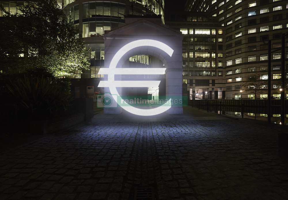 Jan. 14, 2015 - Glowing euro symbol in city street at night, London, UK (Credit Image: © Image Source/Image Source/ZUMAPRESS.com)