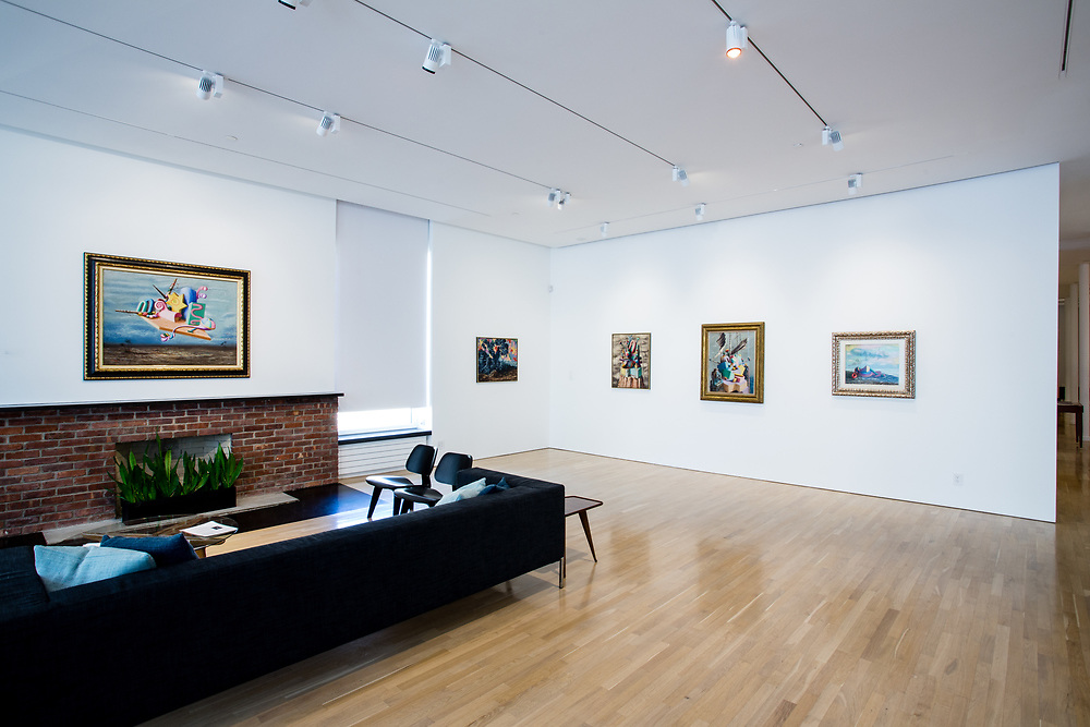 """The main gallery of the Center for Italian Modern Art, with Alberto Savinio's """"I re magi"""" (The Wise Men), over the fireplace."""