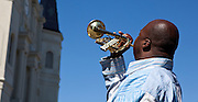 Kenneth Terry plays trumpet with the French Quarter Jackson Square band near St. Louis Cathedral