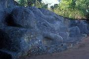 Reclining Buddha statue in stone. Buduruwayaya Ruins