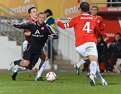 26.11.2010, Bruchwegstadion, Mainz, GER, 1. FBL, FSV Mainz 05 vs 1.FC Nuernberg, im Bild Radoslav ZABAVNIK (Mainz #8), Julian Schieber (Nuernberg #23), Nikolce NOVESKI (Mainz MKD #4), EXPA Pictures © 2010, PhotoCredit: EXPA/ nph/  Roth       ****** out ouf GER ******