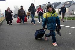 Licensed to London News Pictures. 24/10/2015. Sentilj, Slovenia. Migrants are walking to the border crossing to Spielfeld, Austria Photo: Marko Vanovsek/LNP