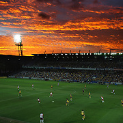 The sun sets over Bluetongue Stadium at Gosford, New South Wales, Australia as the home side, the Central Coast Mariners compete against the Queensland Roar in the Australian Hyundai A-League round 19 match on  January 10, 2009 in Gosford, Australia. The Roar  won the match 4-3.