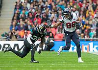 American Football - 2019 NFL Season (NFL International Series, London Games) - Houston Texans vs. Jacksonville Jaguars<br /> <br /> Breon Borders, Cornerback, (Jacksonville Jaguars) comes into tackle Jordan Akins, Tight End, (Houston Texans) at Wembley Stadium.<br /> <br /> COLORSPORT/DANIEL BEARHAM