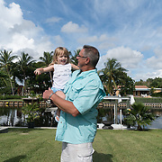 SEPTEMBER 10, 2016----WEST PALM BEACH, FLORIDA<br /> Sean Hockman, 44, and daughter Skylar Hockman, 2,  enjoy the morning sun after protecting themselves with insect repellent their house's backyard on a Saturday morning.<br /> (Photo by Angel Valentin/Freelance Photographer)