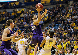 Feb 12, 2018; Morgantown, WV, USA; TCU Horned Frogs guard Kenrich Williams (34) shoots in the lane during the first half against the West Virginia Mountaineers at WVU Coliseum. Mandatory Credit: Ben Queen-USA TODAY Sports