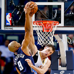 Nov 2, 2013; New Orleans, LA, USA; New Orleans Pelicans power forward Jason Smith (14) blocks a shot by Charlotte Bobcats shooting guard Gerald Henderson (9) during the first quarter of a game at New Orleans Arena. Mandatory Credit: Derick E. Hingle-USA TODAY Sports