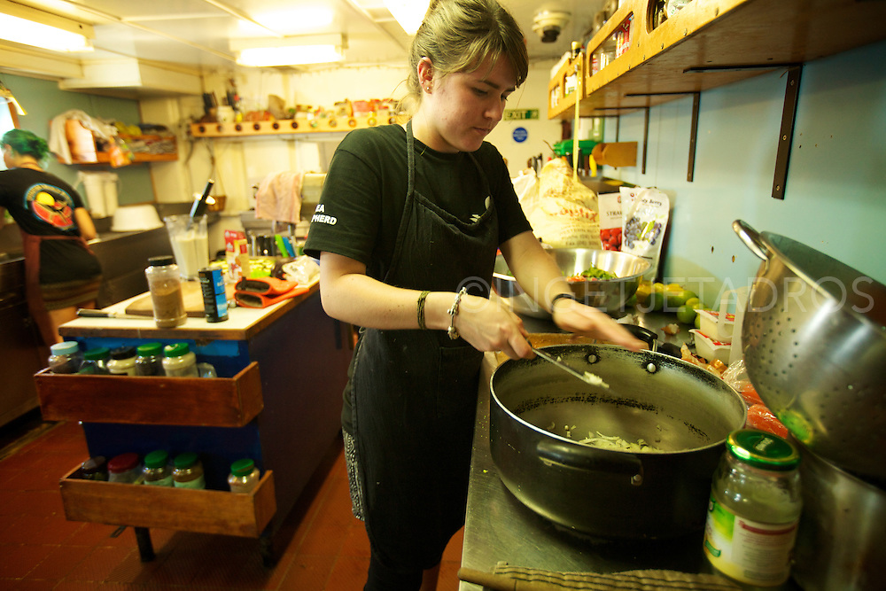 Karlie Darlington, chef's assistant busy preparing lunch in the kitchen of Seashepherd's 'Steve Irwin'.