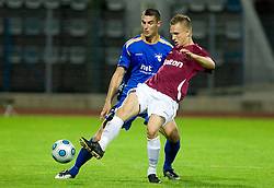 Bojan Dukic of Gorica vs Jonne Kemppinen at 1st football match of 2nd preliminary Round of UEFA Europe League between ND Gorica and FC Lahti, on July 16 2009, in Nova Gorica, Slovenia. (Photo by Vid Ponikvar / Sportida)